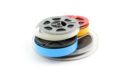 film reels rotating on white background