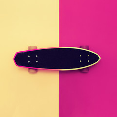 Skateboard on colorful background. Bright style urban