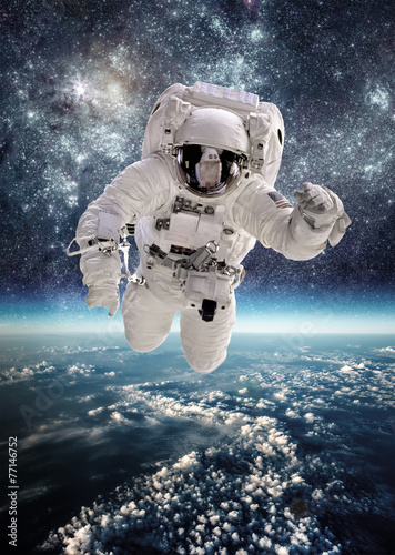 Astronaut in outer space - 77146752