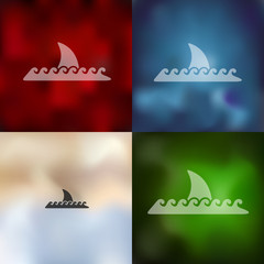 shark icon on blurred background