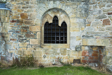 Old stacked stone wall with window