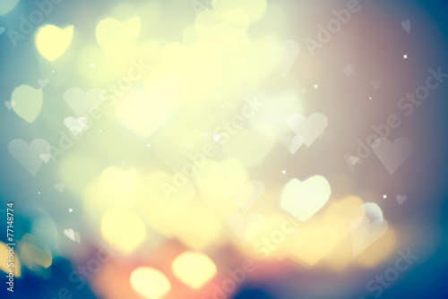 Holiday glowing blurred background. Blinking heart shaped lights