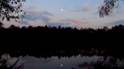 Water landscape with moon. Timelapse.