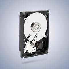 Open hard drive disk on vignette background