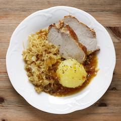Roast pork with raspeball and sauerkraut, Germany