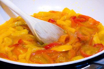 yellow and red peppers while cooking