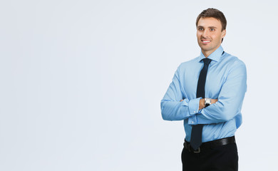 Happy businessman, over grey