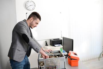 young man computer home repair fixing a computer