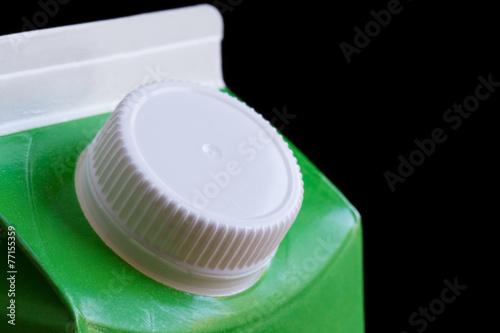Leinwandbild Motiv Top of cardboard milk or drink carton