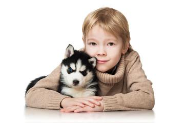 Boy with a puppy husky