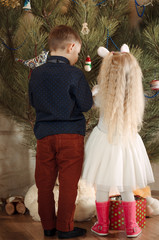 Rear View of Kids Decorating a Christmas Tree