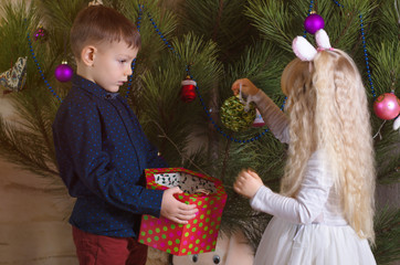 White Kids Amazed with Beautiful Christmas Ball