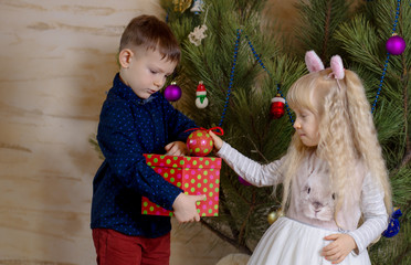 White Kids Preparing Christmas Tree with Balls