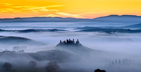 Sunrise and mist in Tuscany Field