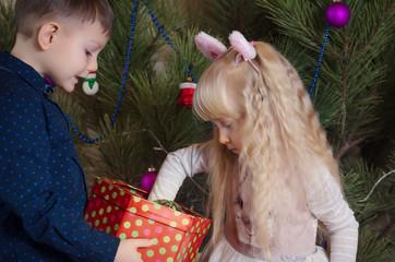 White Kids Preparing Christmas Tree with Balls