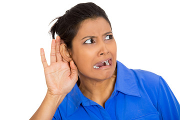 young nosy woman hand to ear gesture secretly listening