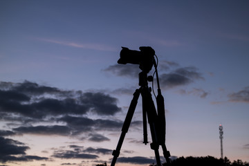 Camera during the dawn, silhouette