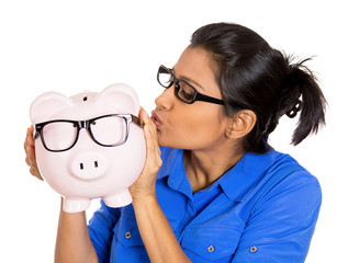 young woman holding piggy bank with big black glasses