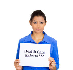 confused sad worker woman holding sign health care reform