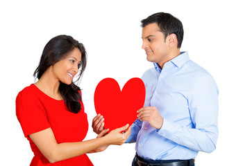 man happily giving red heart and kissing pretty beautiful woman