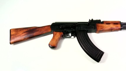 AK 47 beauty-shot, knee-shot of the body section with a slow pan