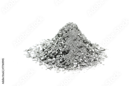 Foto op Plexiglas Metal a handful of silver powder on a white background