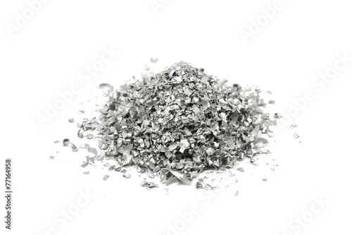 Foto op Canvas Metal a handful of magnesium powder on a white background