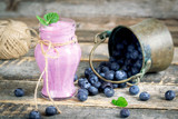 Fresh blueberries yogurt on rustic table