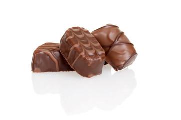three milk chocolates