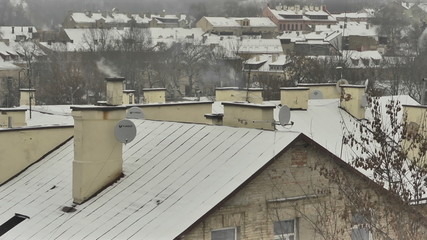 Vilnius. Winter. Snow-covered roof. Zoom out.