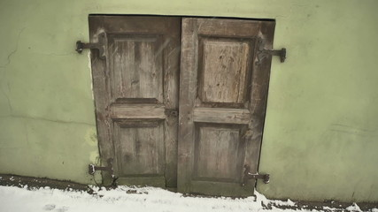 Street in the old town and closed the doors and shutters. PAN