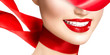 Beautiful model girl with red lips and blowing red silk scarf