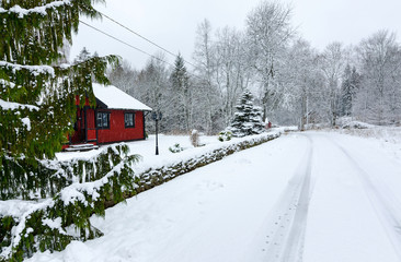Winter landscape of Swedish village road