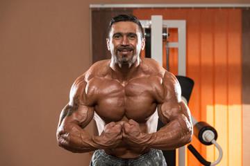 Bodybuilder Making Most Muscular Pose