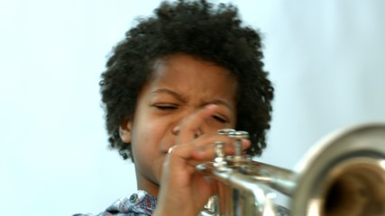 curly african learning to play the trumpet
