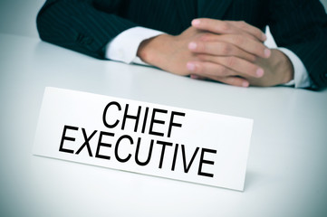 chief executive in his office