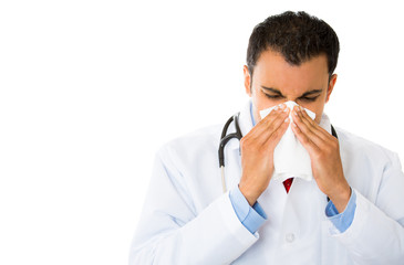 sick doctor, sneezing blowing his nose has cold allergy