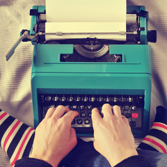 young man typewriting, with a retro effect