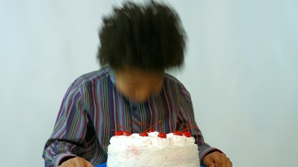 black birthday boy fell with his face in the cake