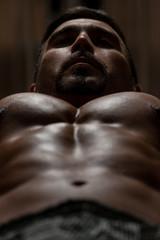Bodybuilder Doing Exercise For Chest With Dumbbells