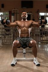 Bodybuilder Exercising Shoulders