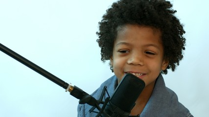 singing african boy with microphone on rack