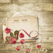 Wooden vintage background with valentines card.
