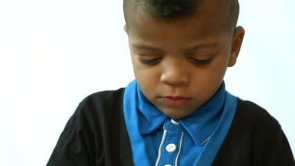 little boy drawing with felt pens