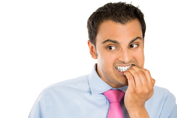 Anxious young man biting his nails craving something