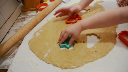 Cooking children are making cookies in the kitchen