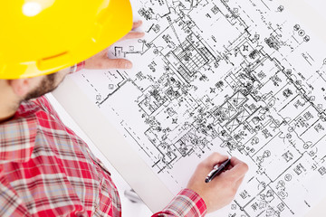 Top view of a architect drawing on blueprint