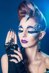 Beautiful woman with stylish hair style art make up portrait