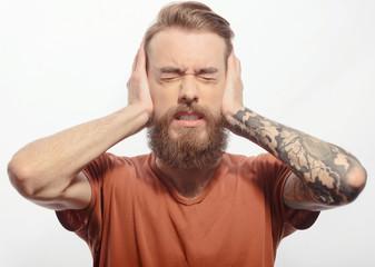 Handsome bearded man with headache