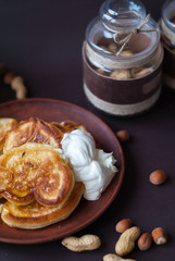 Pancakes with honey and sour cream